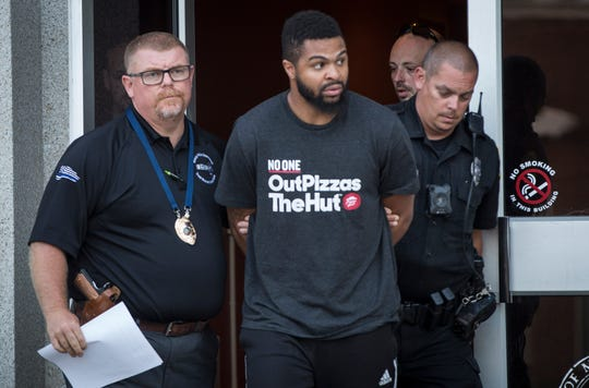 Police lead Devon S. Gaines to the Delaware County Jail on Sunday after he was arrested in connection with the hit and run accident that seriously injured a teenager on West McGalliard Road Saturday night. Gaines, 23, was charged with leaving the scene of an accident resulting in serious bodily injury.