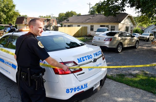 Police place crime scene tape Monday, Aug. 20, 2018, around a home on Dr. DB Todd Jr. Blvd. in Nashville, Tenn., where Demontrey Logsdon was taken into custody for questioning in the previous week's shooting outside The Cobra bar.