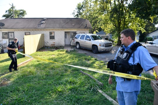Police place crime scene tape Monday, Aug. 20,, 2018, around a home on Dr. DB Todd Jr. Blvd. in Nashville, Tenn., where Demontrey Logsdon was taken into custody for questioning in last week's shooting outside The Cobra bar.