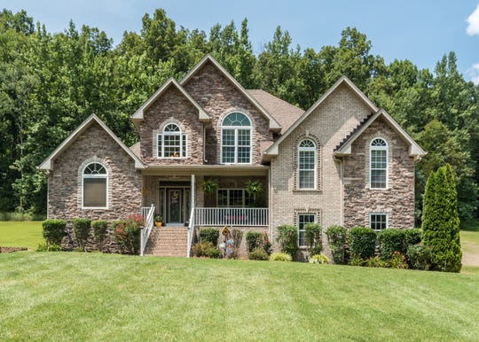 The home at 1931 Shell Road in Hendersonville has a 1-acre yard. The kitchen has stainless appliances and granite countertops.