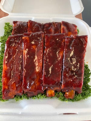 Sauce comes last on the ribs by Hot Cole's Competition BBQ Team.