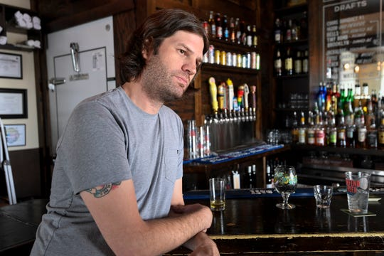 Joey Plunket co-owner of Duke's bar along Main St. urges people to continue supporting East Nashville bars and music venues Monday, Aug. 20, 2018, in Nashville, Tenn.
