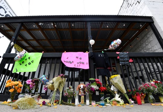 Flowers and mementos rest outside The Cobra bar Monday, Aug. 20, 2018, in memory of two of the three victims killed in a string of unsolved shootings that have terrorized Nashville this month.