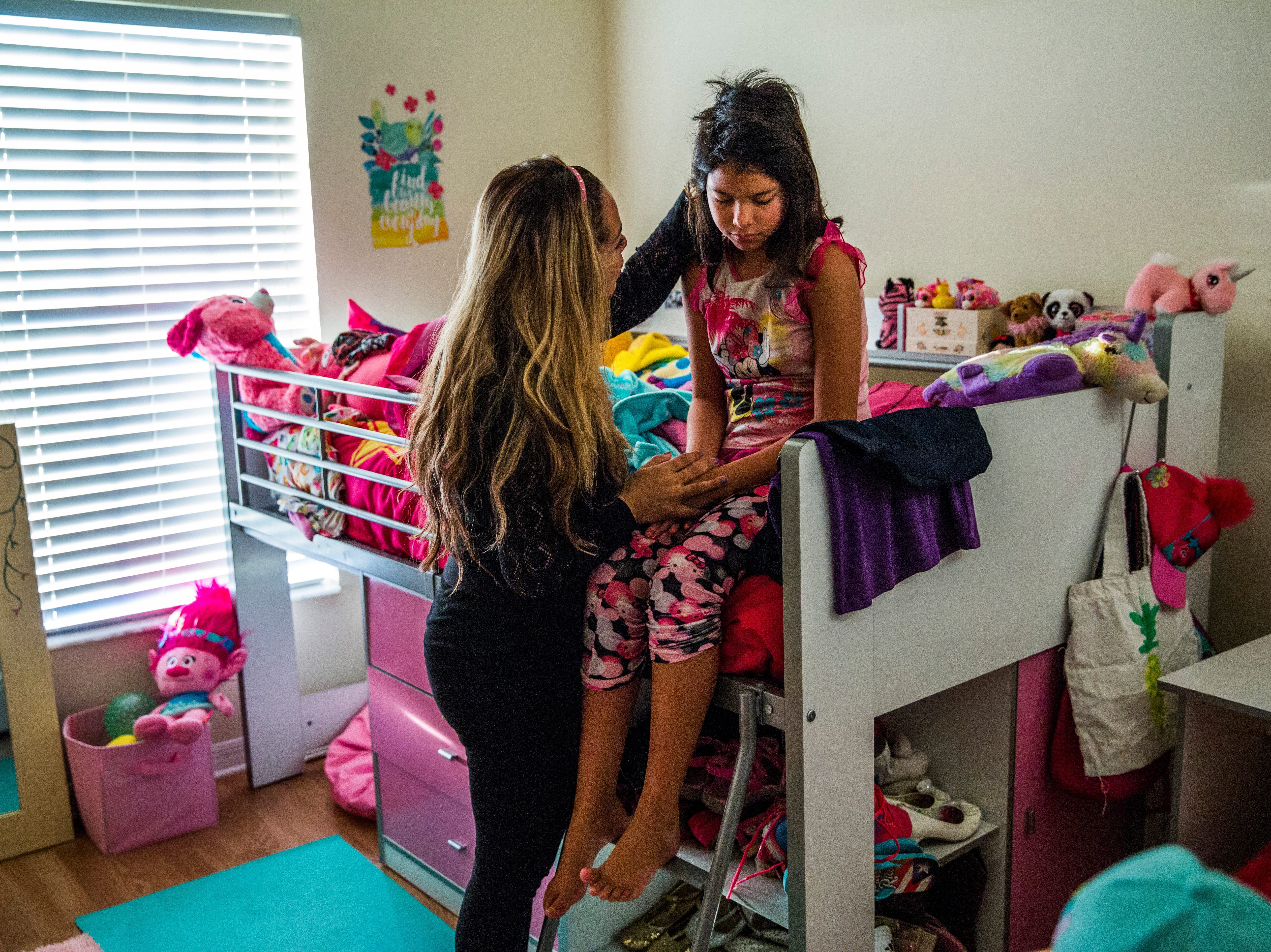 Marcela Guimoye wakes up her daughter Camila Chang, 11, for school in their North Naples home on Thursday, Aug. 16, 2018.