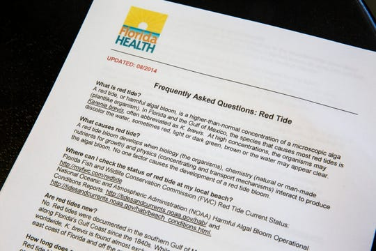 An informational sheet on red tide from the Florida Department of Health sits on a table at CGT Kayaks in Bonita Springs on Monday, August 20, 2018. Even though the Imperial River has clean water flow, their business has dramatically slowed due to the pervasiveness of red tide in the county.