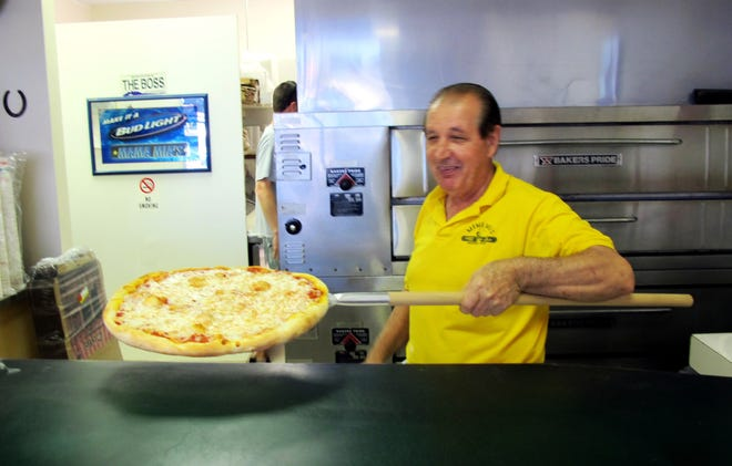 "The late Erminio Iantosca takes one of the first pizzas out of oven at Mama Mia's new location in February 2015. His family wants to memorialze ""The Boss"" with a mural of him on the wall of the longtime pizzeria in Naples."