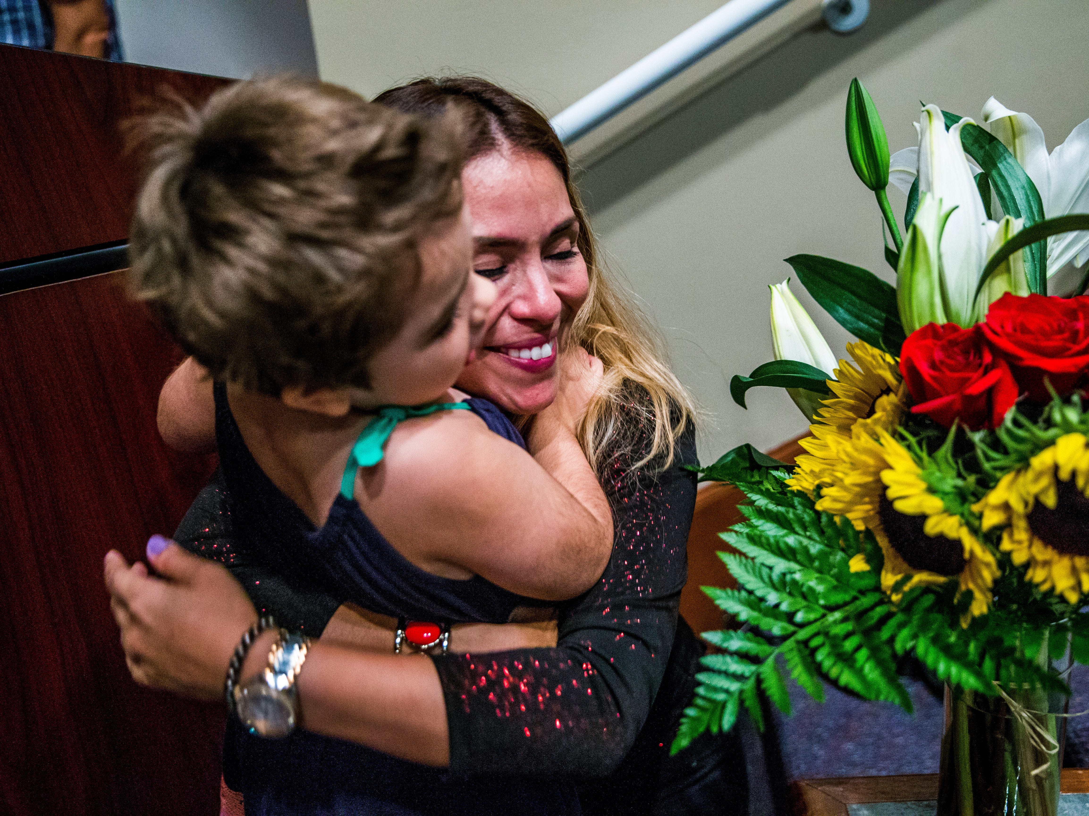 Marcela Guimoye hugs Talley Louise Wilson, 7, after a recital to conclude the EndlessBrain summer camp at the Collier County Library in Naples on Saturday, Aug. 11, 2018. To conclude the camp, Marcela Guimoye put on a recital for the campers to be able to perform the songs they learned during their time with EndlessBrain.