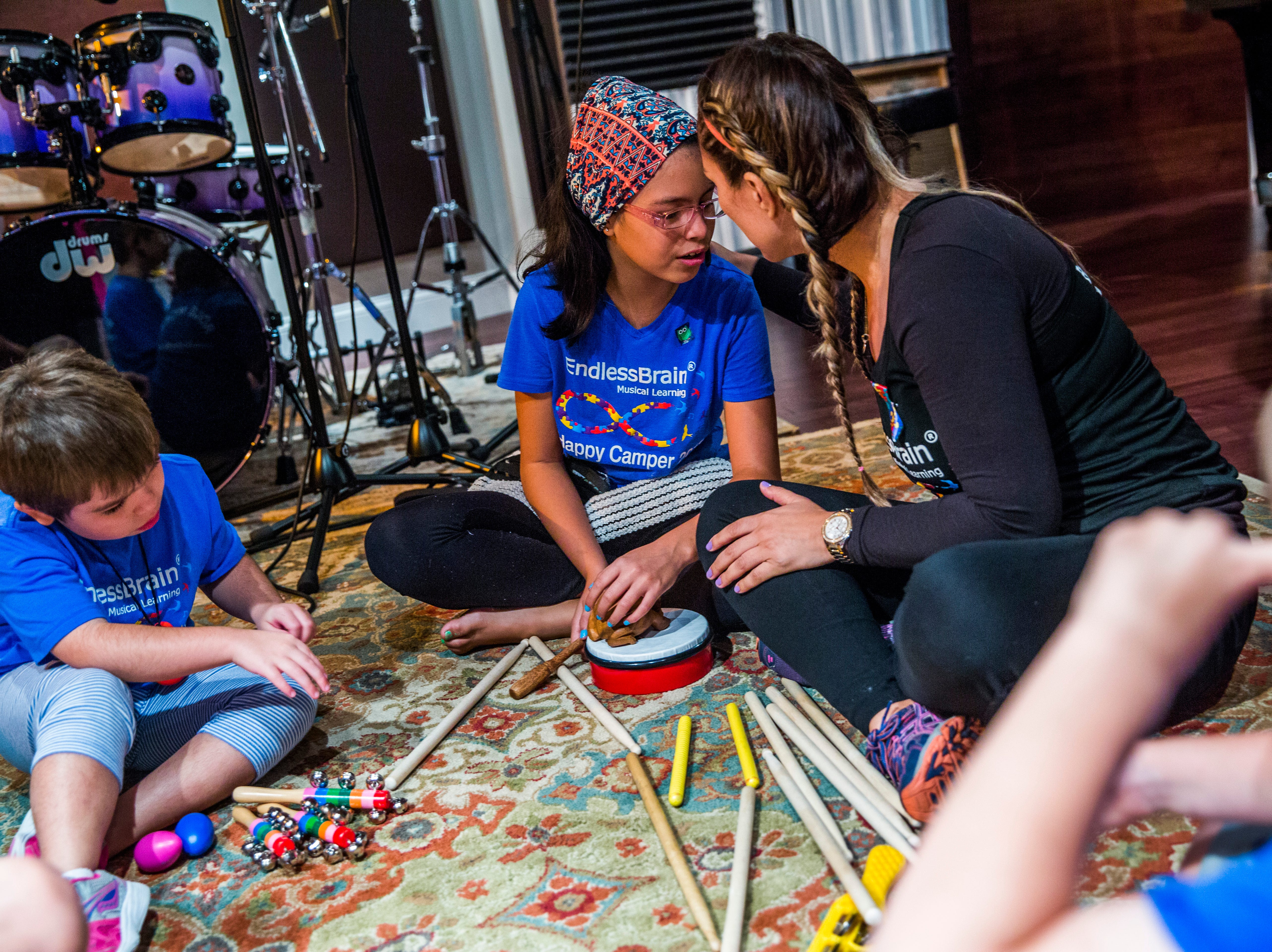 """Marcela Guimoye and her daughter Camila Chang, 11, share a moment together at Mastertrax Recording Studio during the EndlessBrain summer camp in Bonita Springs on Tuesday, Aug. 7, 2018. """"It's (endless brain) all her. It's always been her,"""" Guimoye says of her daughter."""