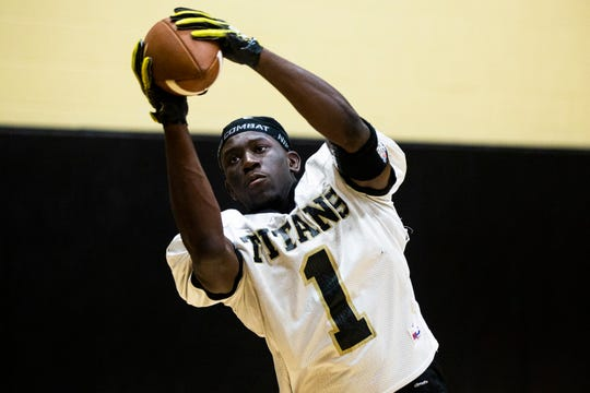 Jouvensly Bazile catches the ball during football practice at Golden Gate High School on Monday, August 20, 2018.