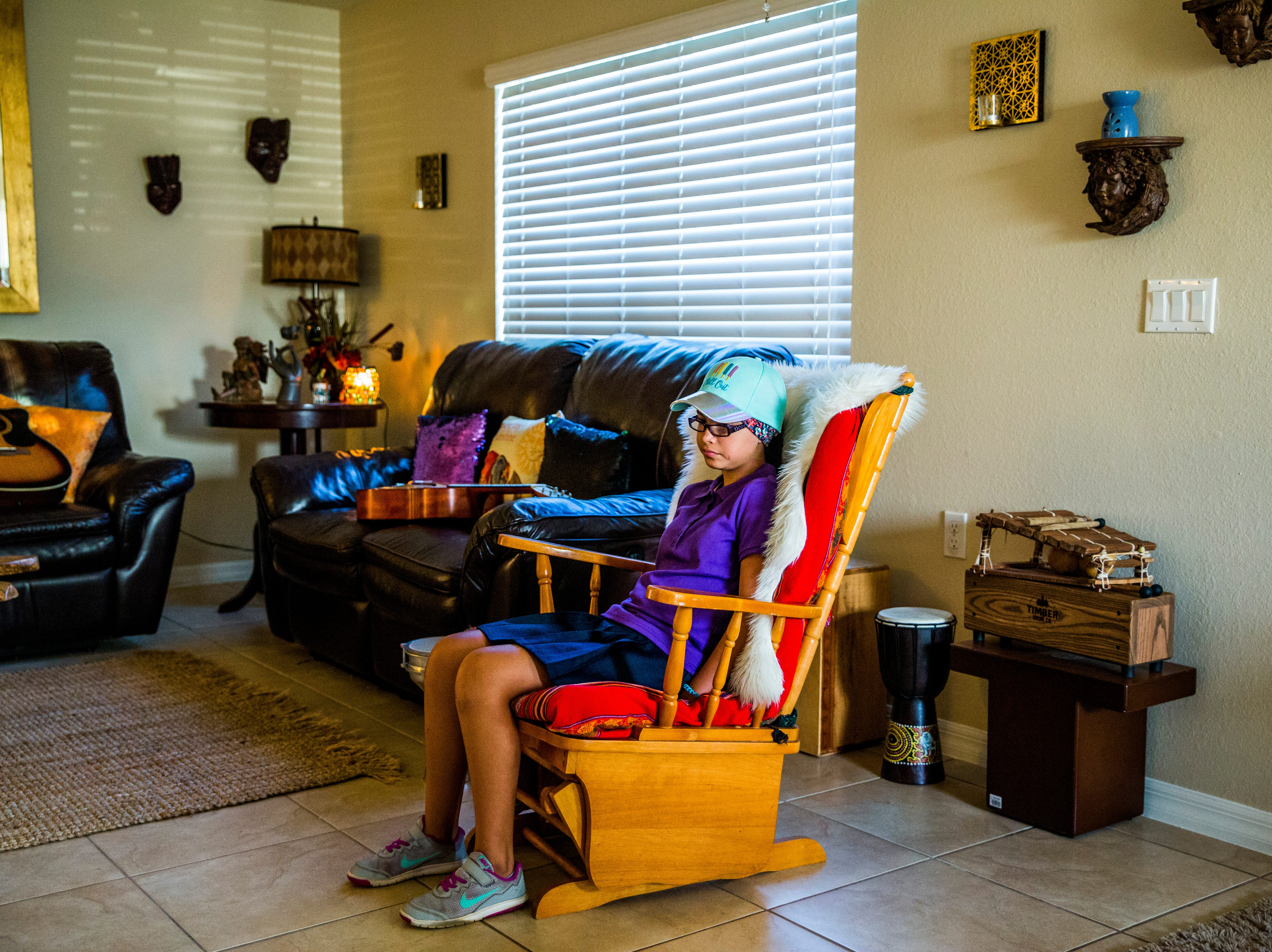 Camila Chang, 11, waits to leave for school in the morning in her North Naples home on Thursday, Aug. 16, 2018.