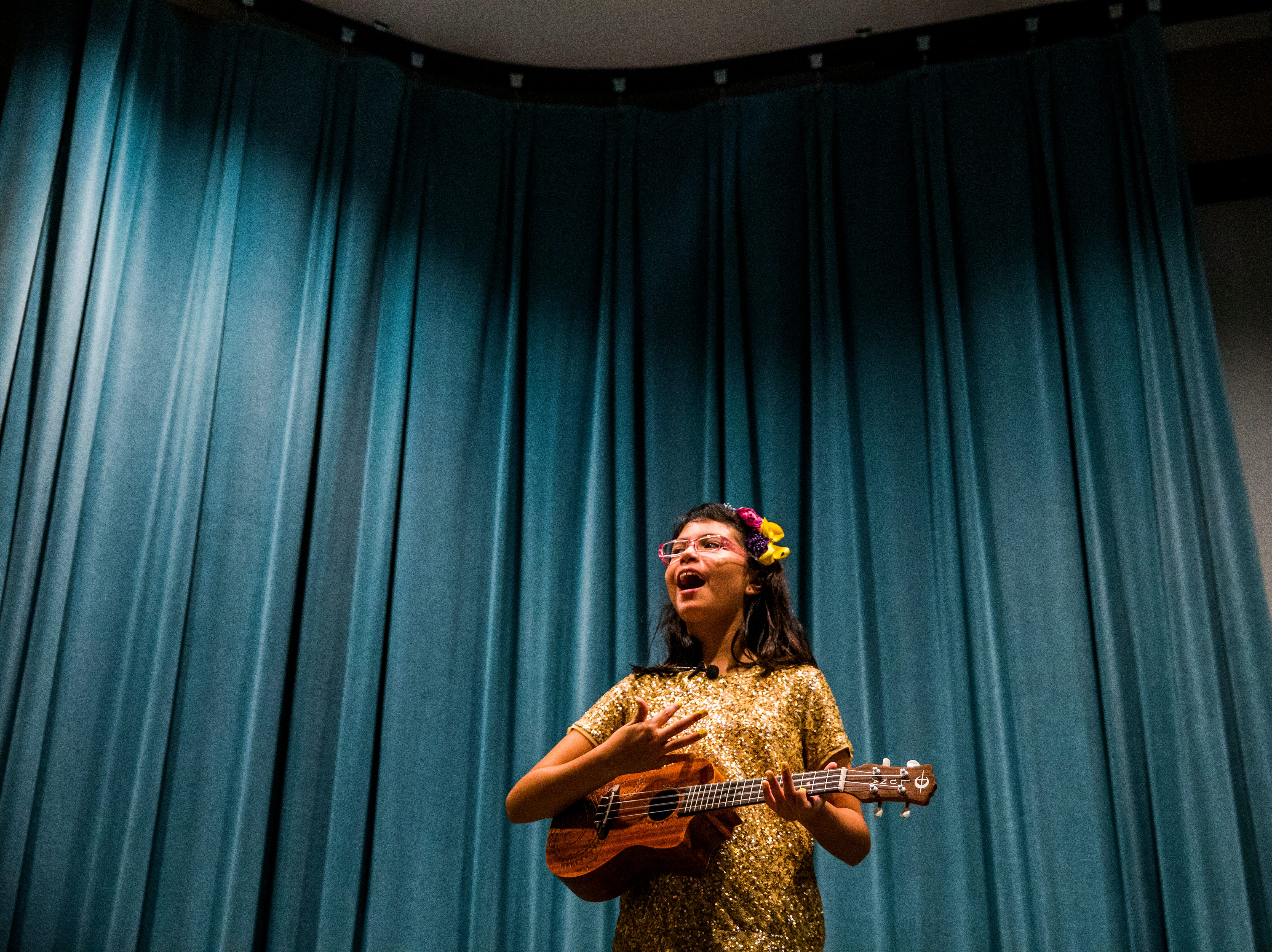 Camila Chang, 11, performs during a recital for friends and family at the Collier County Library in Naples on Saturday, Aug. 11, 2018. To conclude the camp, Marcela Guimoye put on a recital for the campers to be able to perform the songs they learned during their time with EndlessBrain.