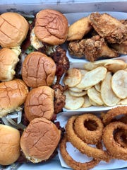 A family box from Burgerim includes eight burgers, eight wings, fries and onion rings.