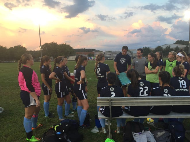 Granville girls soccer coach Scott Forster goes over a defensive alignment during a recent scrimmage against New Albany.