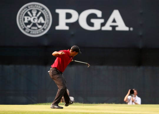 Tiger Woods celebrates his birdie putt on the 18th green during the final round of the PGA Championship golf tournament at Bellerive Country Club, Sunday, Aug. 12, 2018, in St. Louis. (AP Photo/Jeff Roberson)