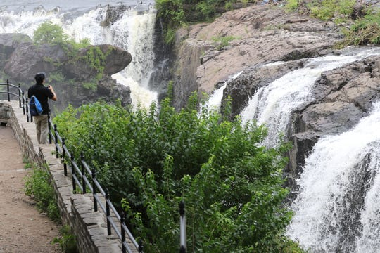 Juan Camilo, who is visiting Paterson from Colombia, views the Great Falls. Monday, August 20, 2018
