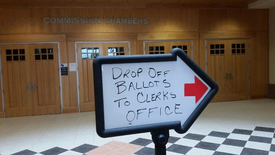 A sign in the Doña Ana County Government Center on Monday, Aug. 20, 2018 directs voter in the city of Las Cruces' general-obligation bond election to the county clerk's office to drop off their ballots. The deadline to submit a filled-out ballot is 7 p.m. Tuesday, Aug. 21.