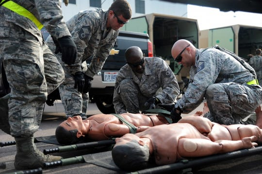 Members of the 927th Aeromedical Staging Squadron secure a litter over a mannequin at Fort McCoy, Wisc. on Aug 15,2018. The litter was for a joint training exercise consisting of onloading and offloading patients during Exercise Patriot Warrior.