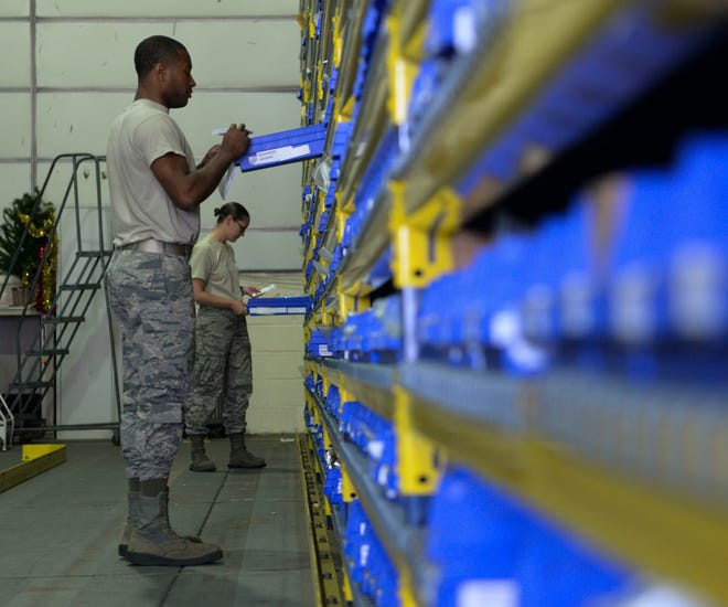 U.S Air Force Airman 1st Class Jimmy Ogletree, 100th Logistics Readiness Squadron aircraft parts store journeyman, front, and Staff Sgt. Morgan Petter, 100th LRS APS supervisor find aircraft parts for an order request at RAF Mildenhall, England, Aug. 8, 2018. The APS supplies the aircraft with mobility readiness spare part kits. Each package is tailored to support an aircraft for the first 30 days of a deployment.