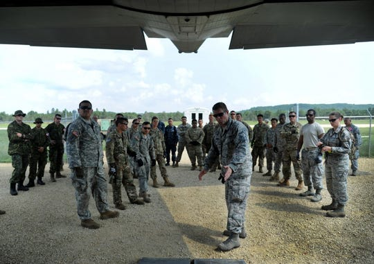U.S. Air Force Senior Master Sgt. Brad Clark, 927th Aeromedical Staging Squadron senior non-commissioned officer in-charge, explains to Reserve Airmen, Soldiers and Sailors how to enter and exit an aircraft during an Engines Running Onload and Offload training scenario on Aug. 15, 2018 at Fort McCoy, Wisc. During the training, servicemembers practiced loading and unloading patients.