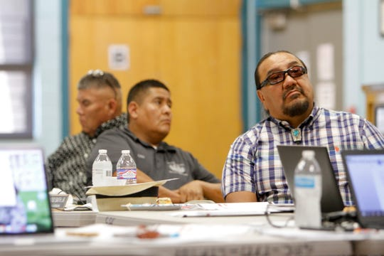 Law and Order Committee members Herman Daniels Jr., left, Chairman Otto Tso and Vice Chairman Raymond Smith Jr. watch a presentation Monday during the 23rd Navajo Nation Council Law and Order Committee meeting at the Shiprock Chapter house.