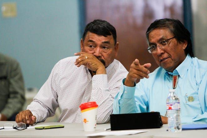 Navajo Nation Council Delegates Tom Chee, left, and Leonard Tsosie talk Monday during the 23rd Navajo Nation Council Law and Order Committee meeting at the Shiprock Chapter house. Tsosie has sponsored a measure that would allow Navajo voters to decide whether to increase the salary of the tribe's president and vice president.