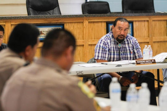 Law and Order Committee Vice Chairman Raymond Smith Jr. listens as representatives from the Navajo Police Department speak Monday during the committee's meeting at the Shiprock Chapter house.