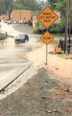 Flooding at the Rio Ruidoso bridge on Friday, Aug. 17. The water moved swiftly down Eagle Drive bringing mud and rocks with it.
