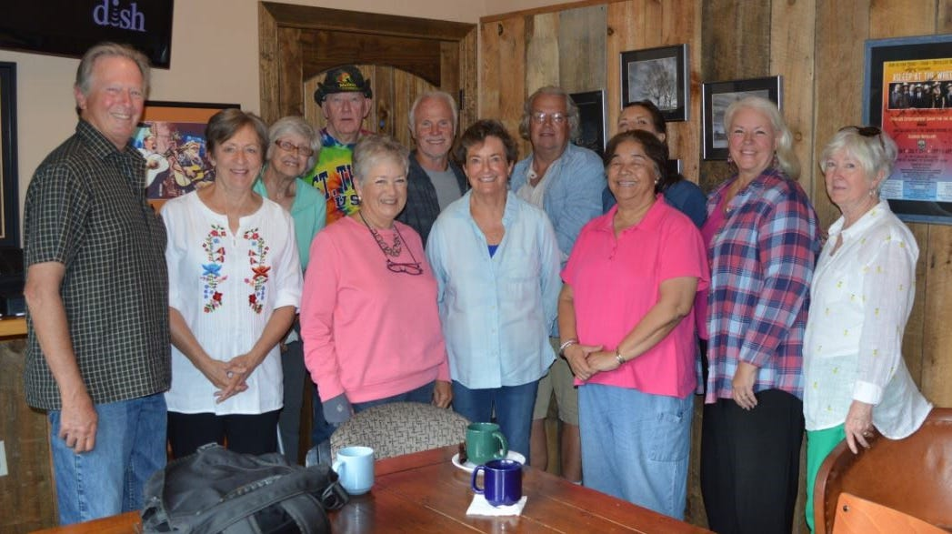 The Care Bearers volunteer drivers conducted a planning session at Sacred Grounds. From left in front are, Dave Tomlin, Chris Long, Margaret Dixson, Clara Farah, Cecile Kinnan, Lola McVey and Shelda Adams. In back from left are Luddy Leong, Jerry Leonard, Danny Watkins, Jeff Bleau, Mary Lou Estes. Not pictured, but also attending was D'Arcy Donaldson.