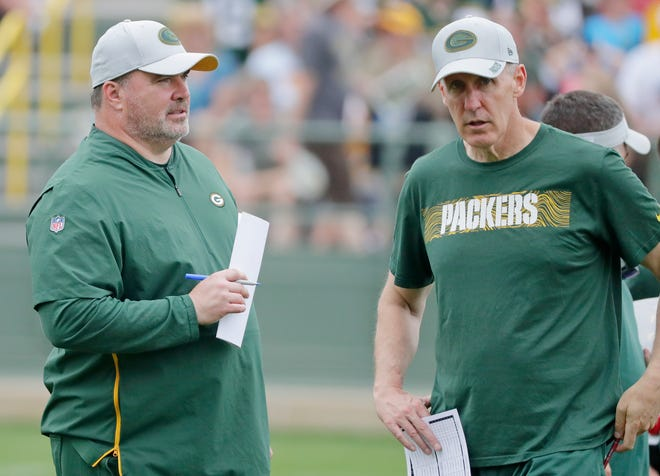 Green Bay Packers head coach Mike McCarthy and offensive coordinator Joe Philbin talk during training camp practice at Ray Nitschke Field on Monday, August 20, 2018 in Ashwaubenon, Wis.