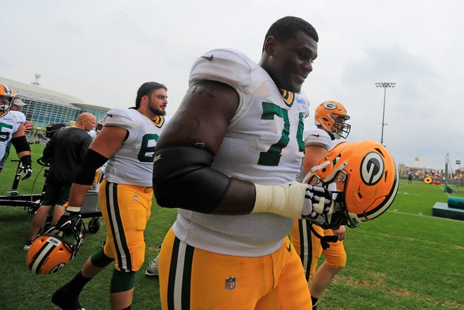 Green Bay Packers offensive tackle Byron Bell (74) walks onto the field during training camp practice at Ray Nitschke Field on Monday, August 20, 2018 in Ashwaubenon, Wis.