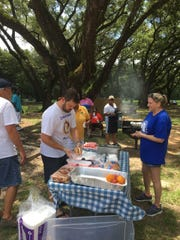 Cantonment Rotary members serve burgers at a back-to-school bash at Carver Park in north Escambia County on Aug. 11, 2018.