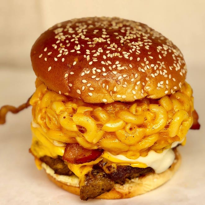 Copper Bull Bar & Grill serves a variety of gourmet burgers, including its signature Mac-N-Cheese Burger.