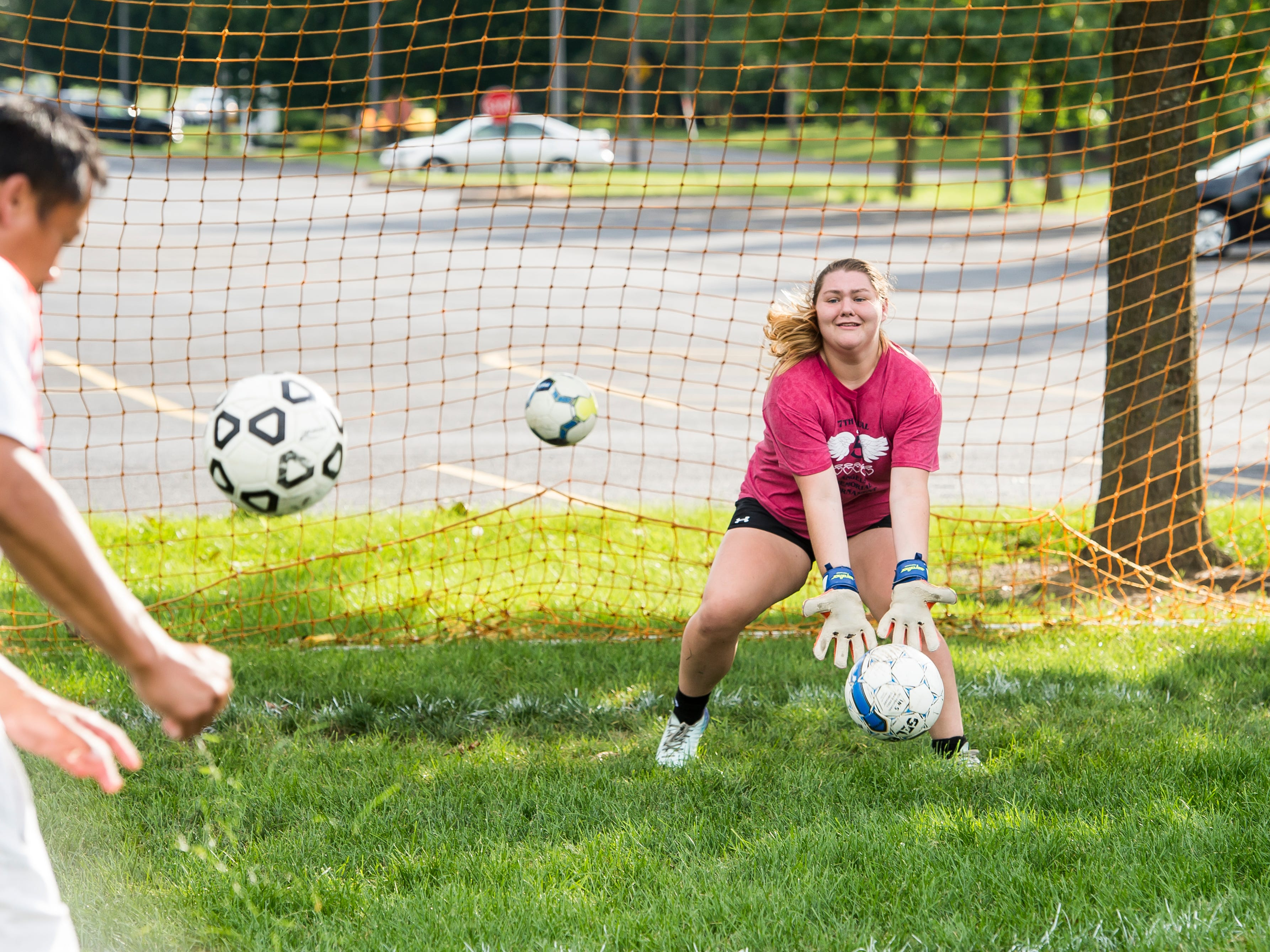 Fairfield goalkeeper Taylor Scott blocks a shot during a rapid fire drill during practice on Monday, August 13, 2018.