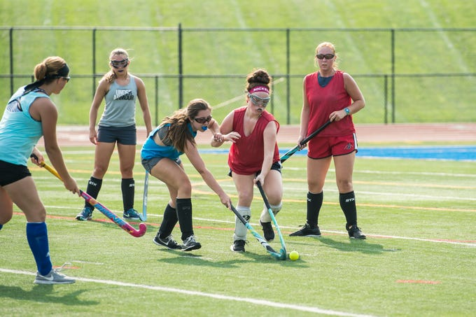 Spring Grove field hockey players scrimmage during practice on Monday, August 15, 2018.