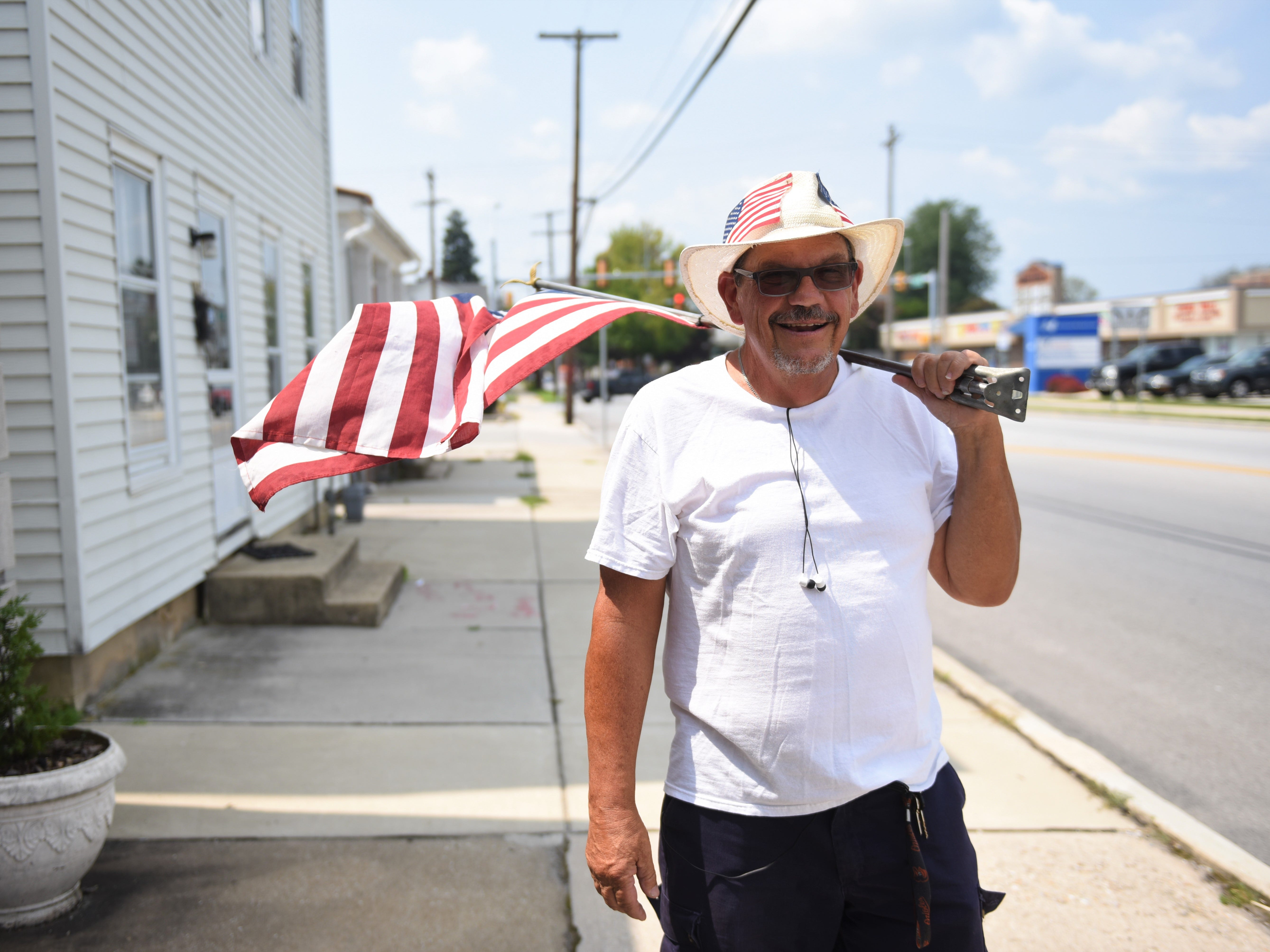 Meet the man walking around Hanover with the American flag on his shoulder