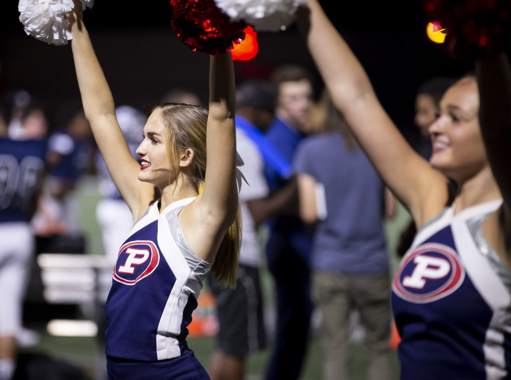 Pinnacle cheerleader Shaye Bergstrom cheers during the game against the Perry Pumas at Pinnacle High School on Friday, August 17, 2018 in Phoenix, Arizona.
