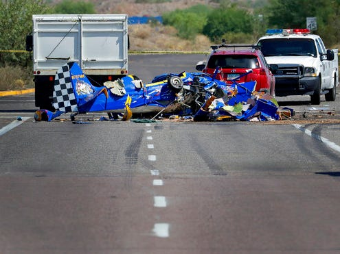 The wreckage of a small plane sits in an intersection Monday, Aug. 20, 2018, in Phoenix. The plane went down near the city's Deer Valley Airport.