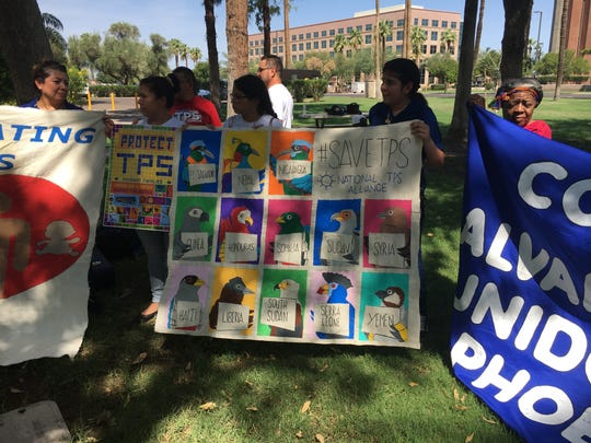 A caravan of immigrants is traveling across the country to protest the Trump administration's phase-out of temporary protections for several hundred thousand immigrants from countries recovering from war and natural disaster. Immigrants from the caravan held up signs listing countries with Temporary Protected Status, including El Salvador, Haiti, Honduras, Nicaragua and Sudan.