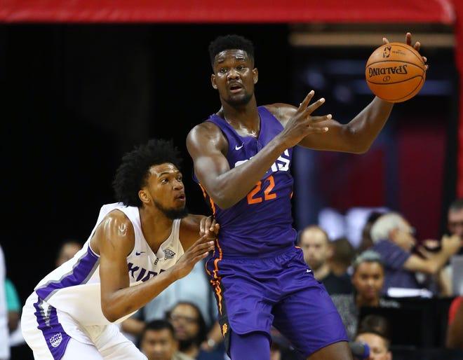 Phoenix Suns center Deandre Ayton (right) is a Phoenix Mercury fan.