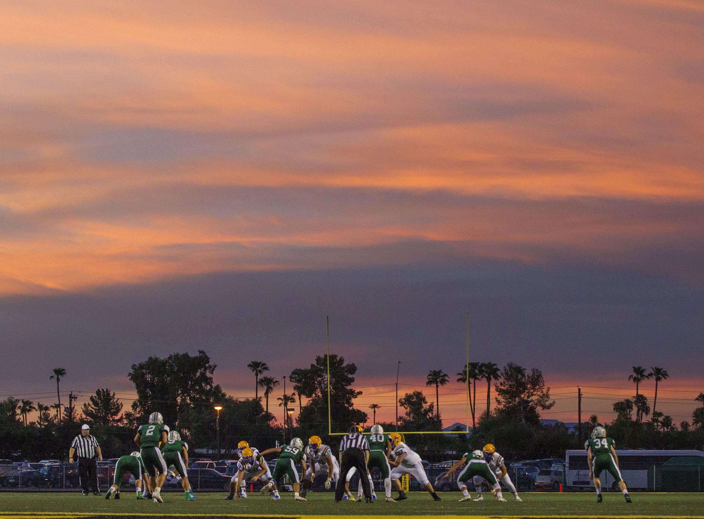 Marana and Horizon start on their football season off under ominous skies Friday, Aug.17, 2018.