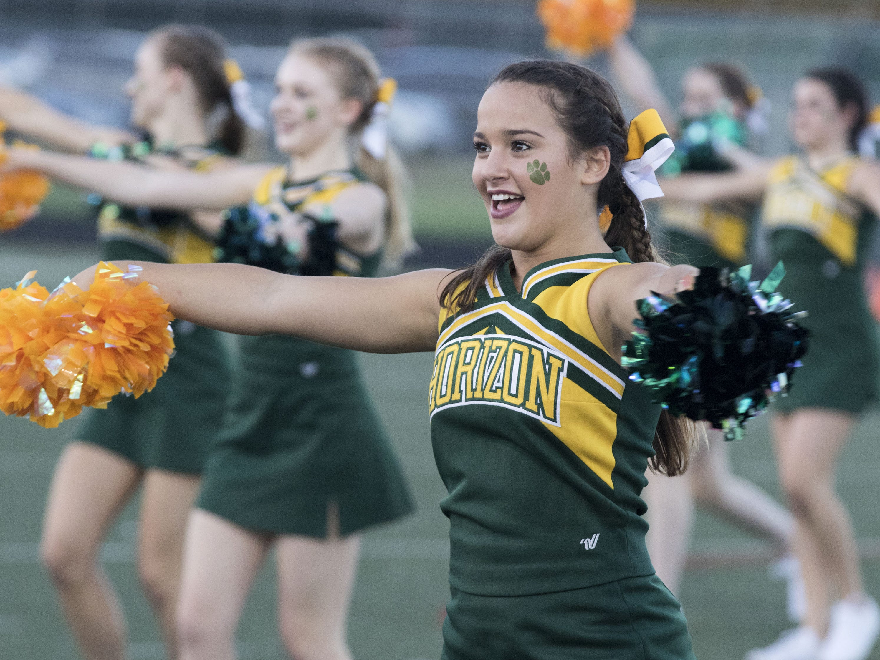 Horizon's cheerleaders entertain the crowd before their game with Marana Friday, Aug.17, 2018.