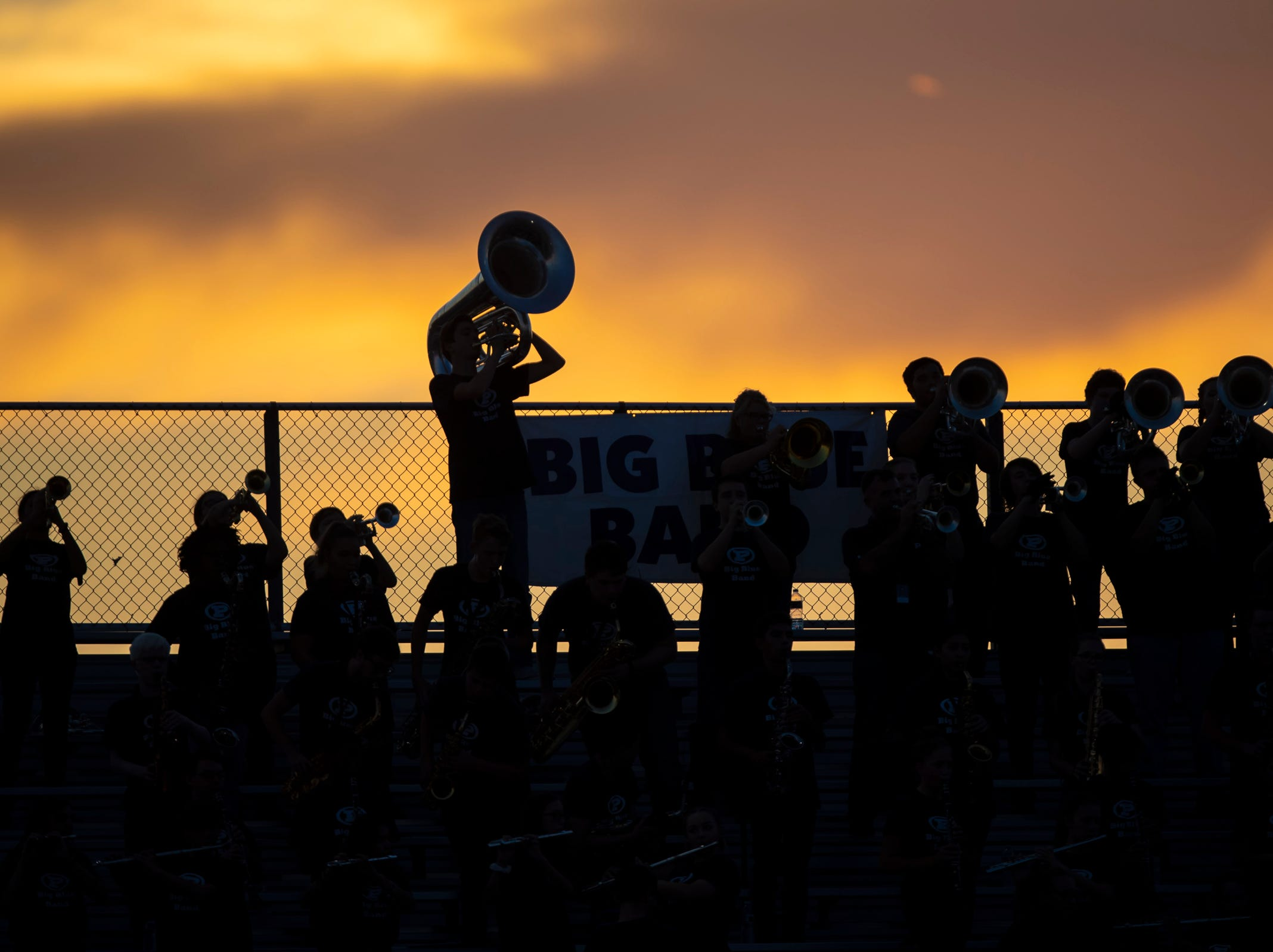 The Pinnacle Pioneers Marching Band performs prior to the game against the Perry Pumas at Pinnacle High School on Friday, August 17, 2018 in Phoenix, Arizona.