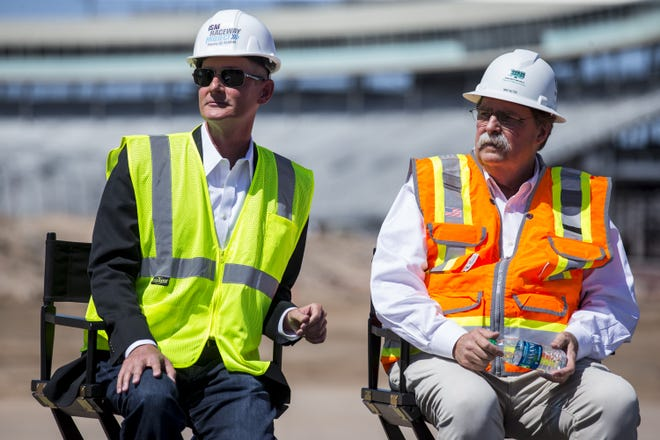 ISM Raceway track president Bryan Sperber (left) and NASCAR vice chairman Mike Helton listen during a press conference before the demolition of the race control tower on Wednesday, May 30, 2018 at ISM Raceway in Avondale, Ariz.