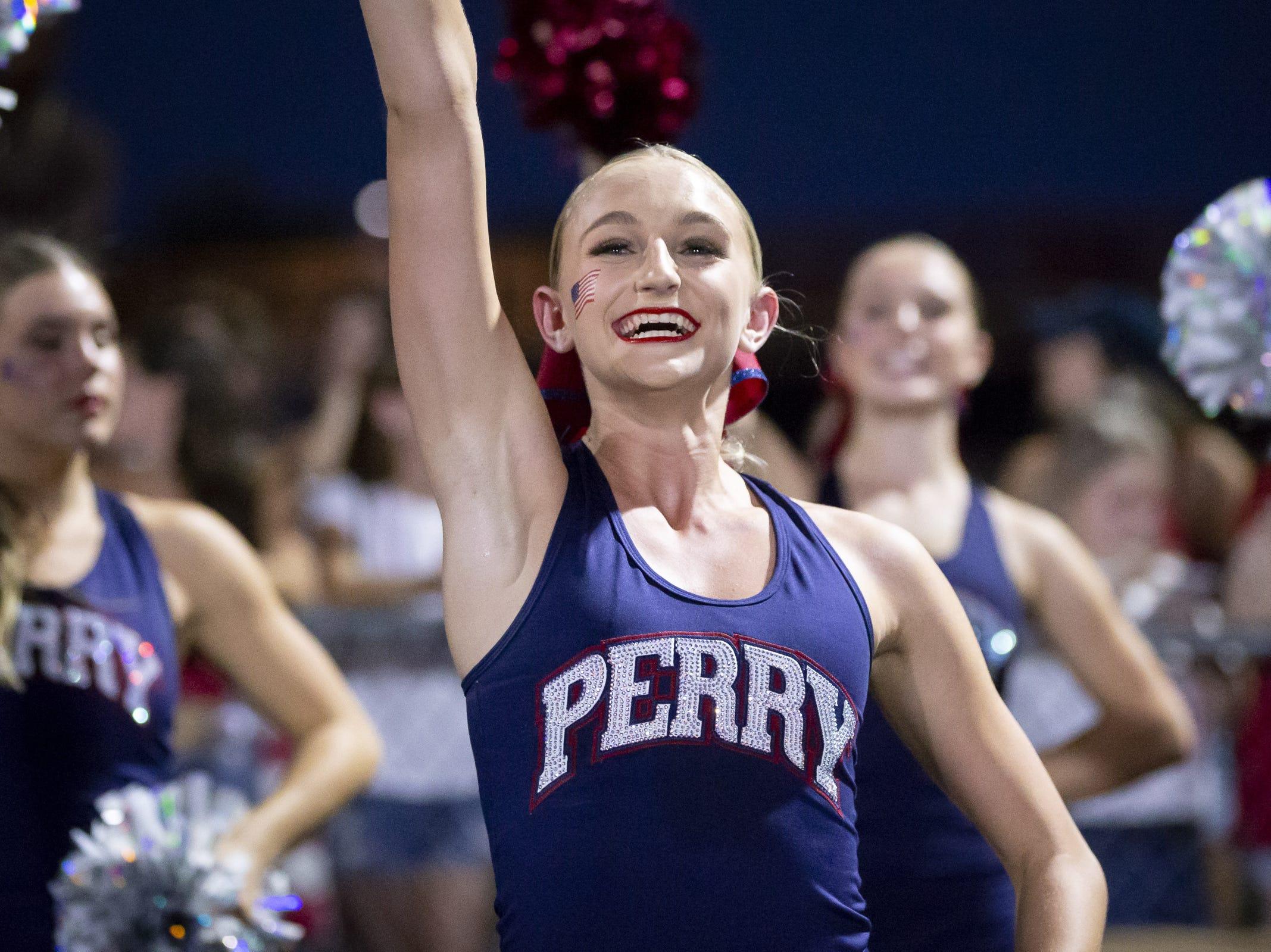 A Perry cheerleader cheers during the game against the Pinnacle Pioneers at Pinnacle High School on Friday, August 17, 2018 in Phoenix, Arizona.