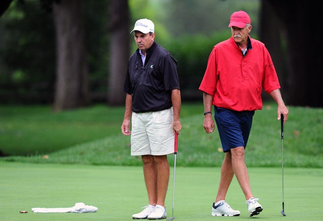Rick Troutman (right) helps his partner Greg Ulp line up a par putt on the 8th hole that they needed to halve the hole during play in the final match of the 73rd W.B. Sullivan Four-ball Invitational at the Lebanon Country Club Sunday August 19, 2018.