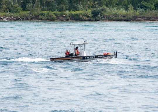 A St. Clair County Sheriff's dive team boat heads downbound along the St. Clair River Sunday, Aug. 19, 2018, before the start of the annual Float Down.