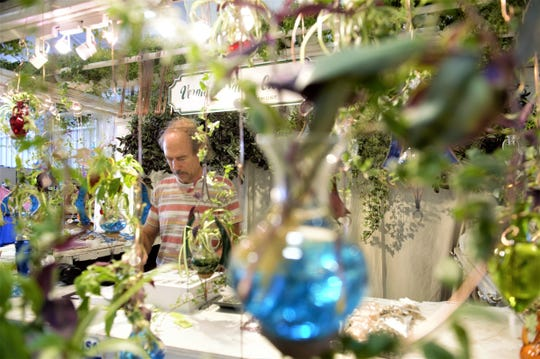 David Emmons, owner of Vermont Nature Gardens, said he has been a vendor at the Dutchess County Fair for seven years. He is selling handmade hanging vases with live plants as seen on Monday, Aug. 20, 2018.