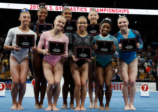 The U.S. women's national gymnastics team poses after the U.S. Gymnastics Championships, Sunday, Aug. 19, 2018, in Boston. From left are Grace McCallum, Trinity Thomas, Riley McCusker, Shilese Jones, Morgan Hurd, Kara Eaker, Simone Biles and Jade Carey. (AP Photo/Elise Amendola)