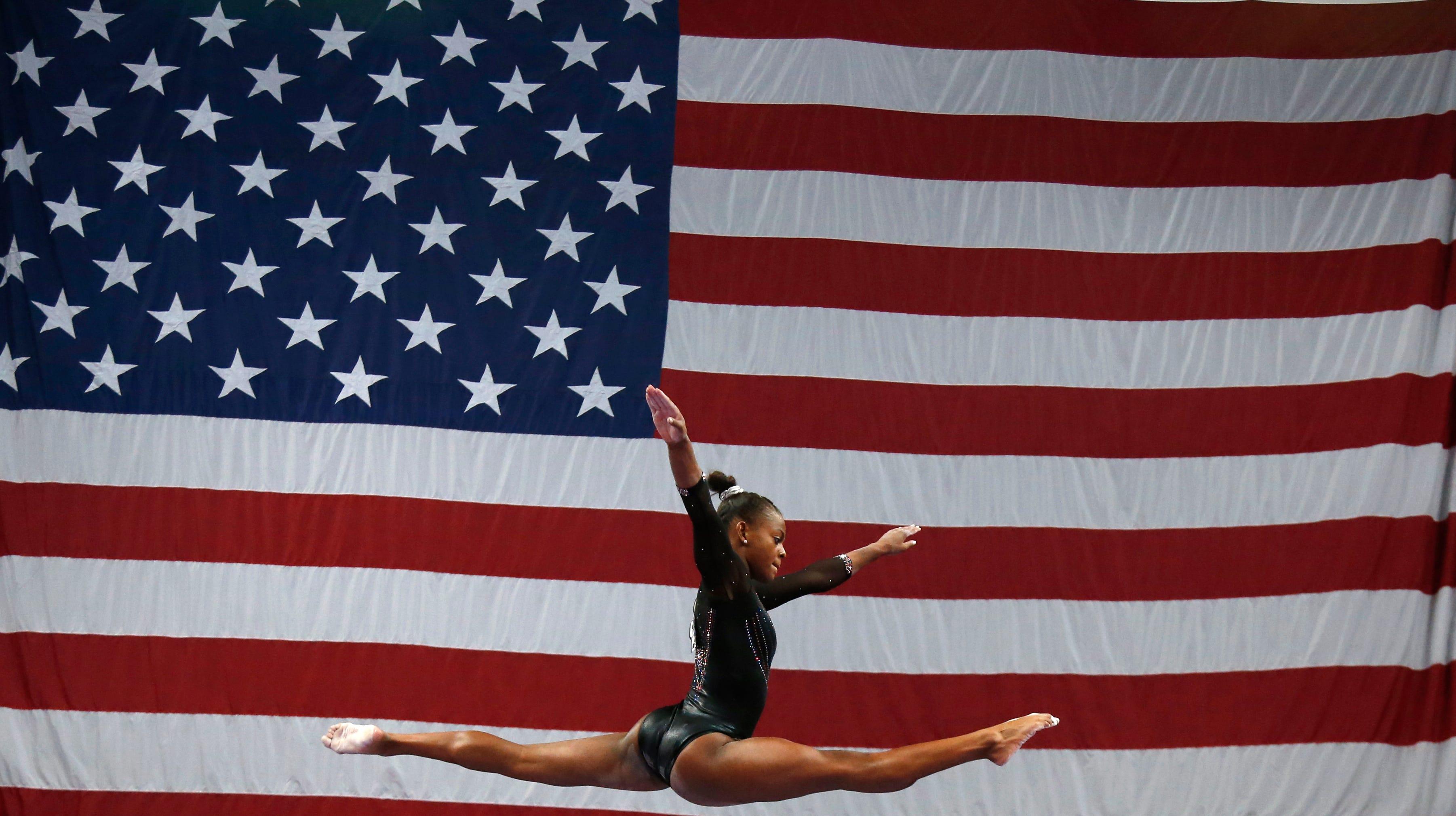 Trinity Thomas competes on the balance beam at the U.S. Gymnastics Championships, Sunday, Aug. 19, 2018, in Boston. (AP Photo/Elise Amendola)