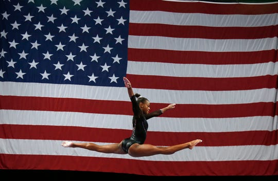 Trinity Thomas competes on the balance beam at the U.S. Gymnastics Championships, Sunday, Aug. 19, 2018, in Boston. (AP Photo/Elise Amendola)